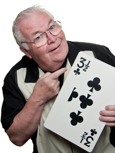 Professional magician Al Lampkin holding a large card