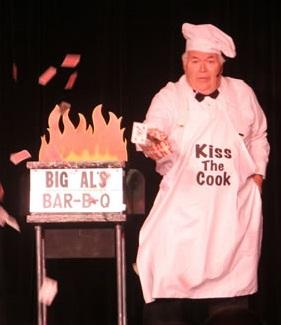 Corporate entertainer Al Lampkin stabbing a card